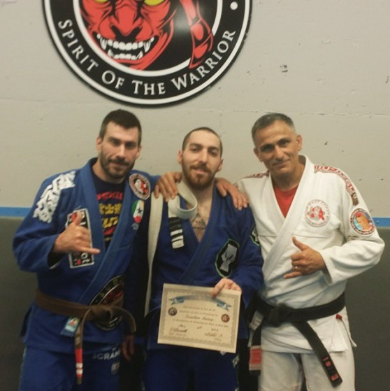 Jonathan Fader receiving his BJJ Blue Belt from Don and Scott