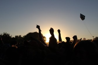 The crowd sways along to music at sunset on Saturday.