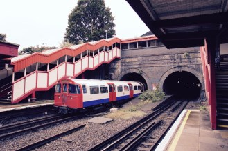 Northbound Bakerloo train heading through the tunnel which takes the railway towards Willesden Junction.