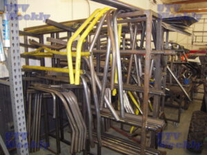 Cages ready to ship line the walls, and pre-cut and bent pieces are staged