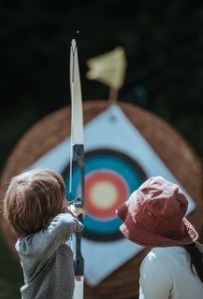 Boy archer aiming at target