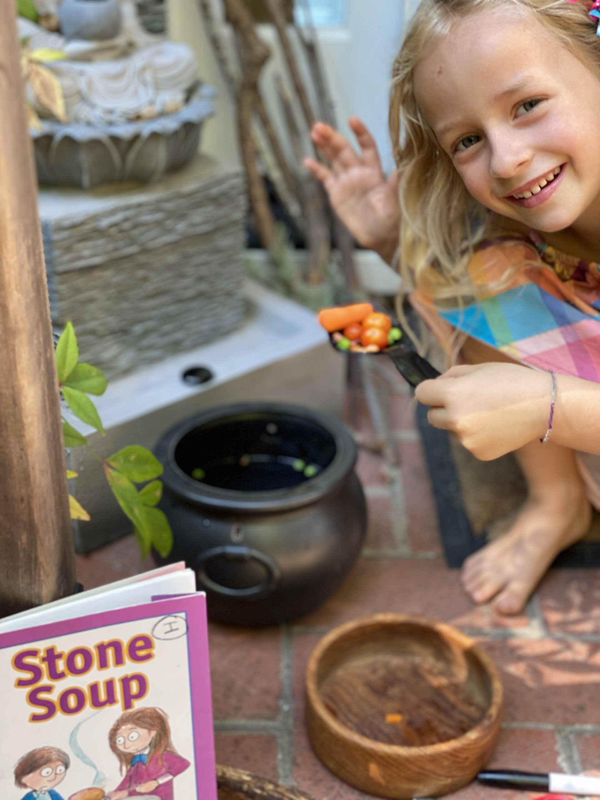 Child preparing stone soup.