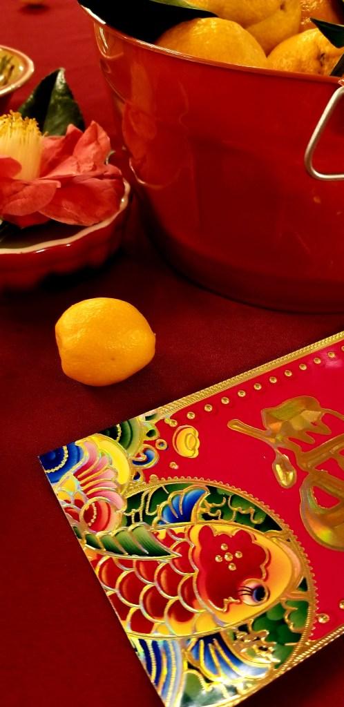 centerpiece of flowers, lemons, and koi card