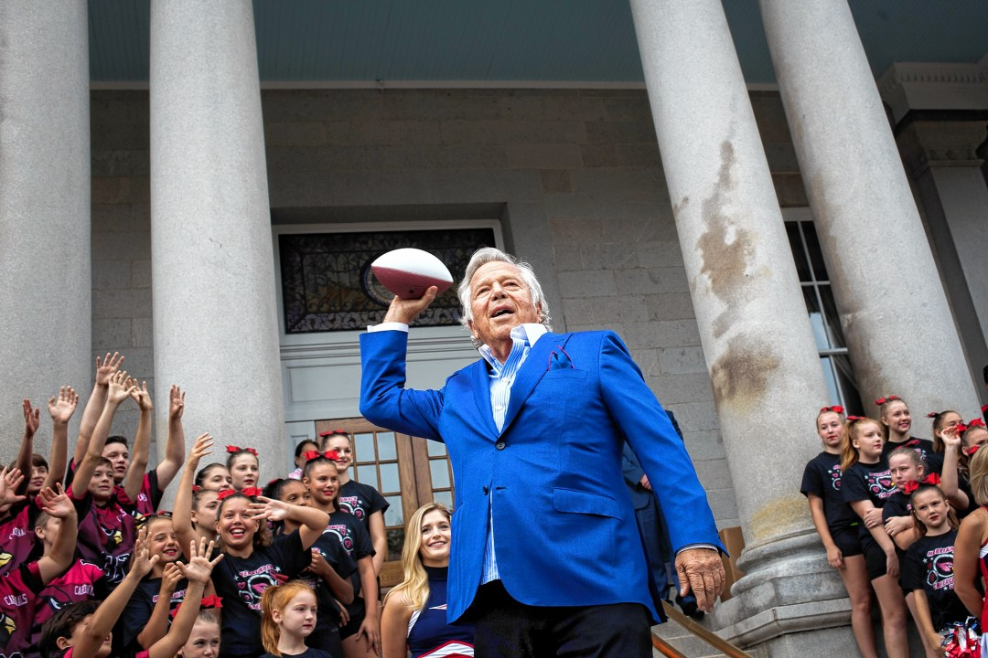 New England Patriots Chairman and CEO Robert Kraft throws a football into the crowd following a launch of a Patriots New Hampshire Lottery scratch ticket game at the State House in Concord on Tuesday, Aug. 29, 2017.