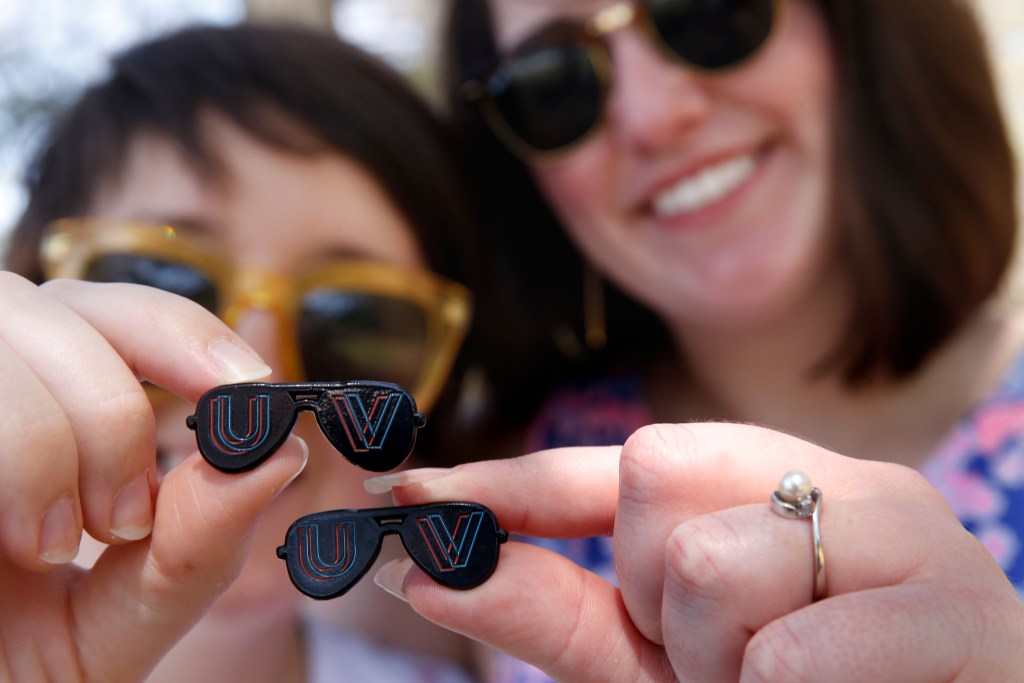 UV Index editors Maggie Cassidy and Amanda Newman and their promotional pins in West Lebanon, N.H., on May 2, 2018. (Valley News - Geoff Hansen) Copyright Valley News. May not be reprinted or used online without permission. Send requests to permission@vnews.com.