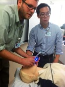 """Rich Smith '16 and Mike Sun '16 monitor their """"patient."""""""