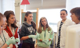Participants in Girls Science Discovery Day listen to UVM Professor of Neurological Sciences Diane Jaworkski, Ph.D.