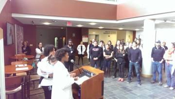 Desiree DiBella '19 speaks at the White Coats 4 Black Lives gathering.