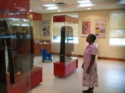 Visitor viewing the 'official robes' for the Chancellor, Vice Chancellor and Pro Vice Chancellor of the UWI.