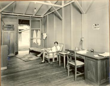 Male student relaxes in spacious Gibraltar Hall room (Photo from UWI Mona Library Historic Photographs Collection)