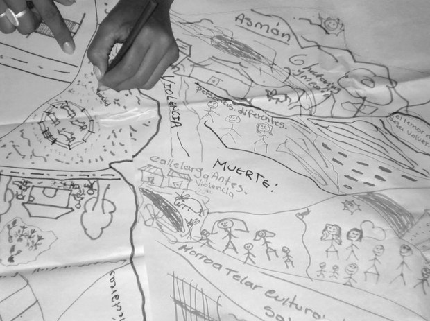 woman drawing map with local history of violence and land dispossession