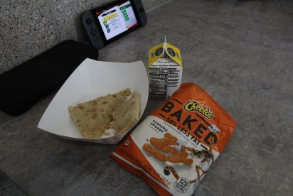 Sophmore Trevor Bickford's lunch consists of low-fat white milk, a quesadilla, and a low-fat bag of Cheetos on Mar. 2. All of these food meet the state nutrition requirements.