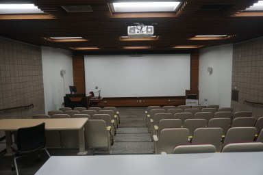 Renovations to the only inclined classroom. Photo is taken from the former site of the projectionist booth and illustrates the opening of the space by taking out center row of seats and removal of short walls at the room front.
