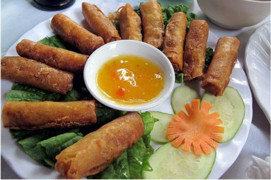 a plate full of spring rolls
