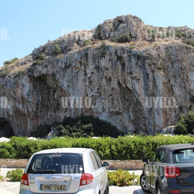 Car and Rock in the Area Lake Vouliagmeni, Attica Greece