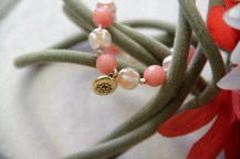 agate-coral-jade-w-tibean-white-spot-and-fire-polished-czech-lotus-charm