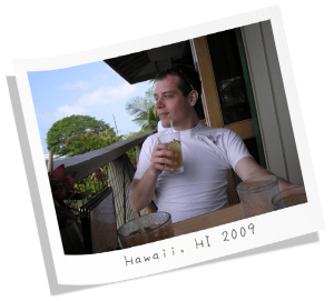 Me sipping a passion fruit beverage in Hawaii in 2009.