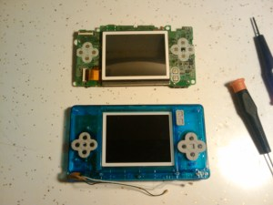 Bottom shell entirely removed; halves separated.