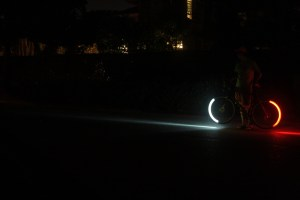 view of Revolights installed on bike (shows forward lighting distance)