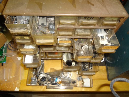 Component bins of transistors and miscellaneous parts.