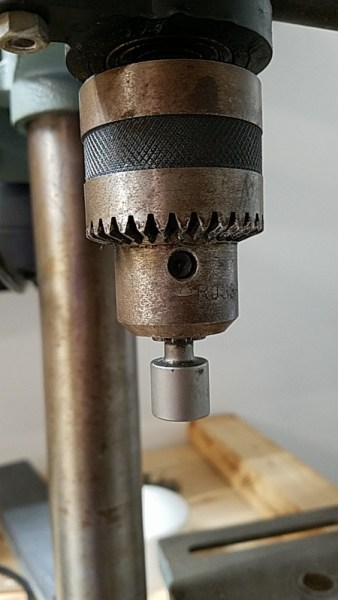 Nut driver attached to the drill press