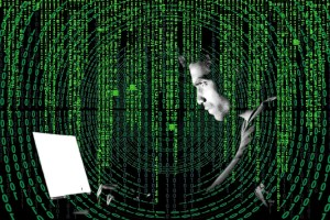 man hacking laptop - Prevent Malware From Infecting Your Computer: Use These Best Practices