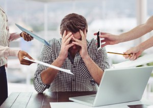 man overwhelmed with work 300x212 - 4 Signs It's Time to Outsource Your IT Services