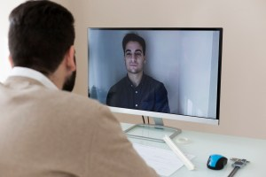 men video chatting on computer - VoIP 101: The Top 4 Benefits for Businesses