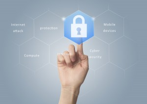 cyber security finger pointing to lock - Vulnerability Management: 4 Essential Steps to Protect Your Business From Cyberthreats