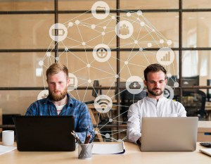 2 men working on laptops - In-House Security Training: Knowledge That Everyone Should Know