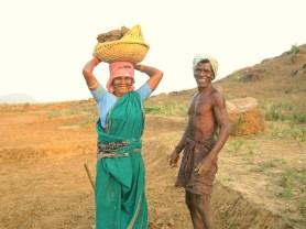 woman-carrying-rocks-on-head