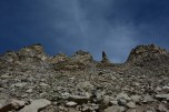 'Provoke us and we slither down the mountain track crushing you' , says the embedded rocks