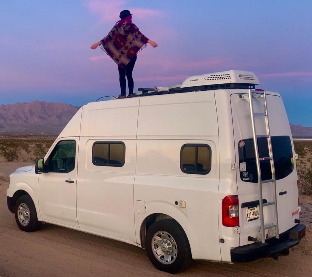 vacay vans solo girl on diy vanlife camper van in desert sunset