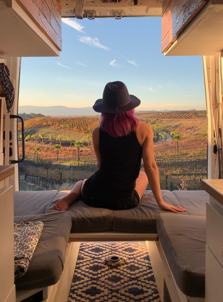 vacay vans girl in camper van cowboy hat california wine country