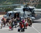 Iindian Air Force personnel rescuing stranded passengers from Reckong Peo in Kinnaur district in Himachal Pradesh on Thursday. Kinnaur was among the worst affected areas due to recent floods in Himalayan region.