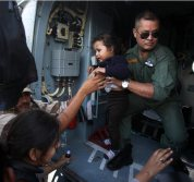 A child is rescued from Guptakashi by Indian Air Force near flood-hit Kedarnath in Uttarakhand on Thursday.