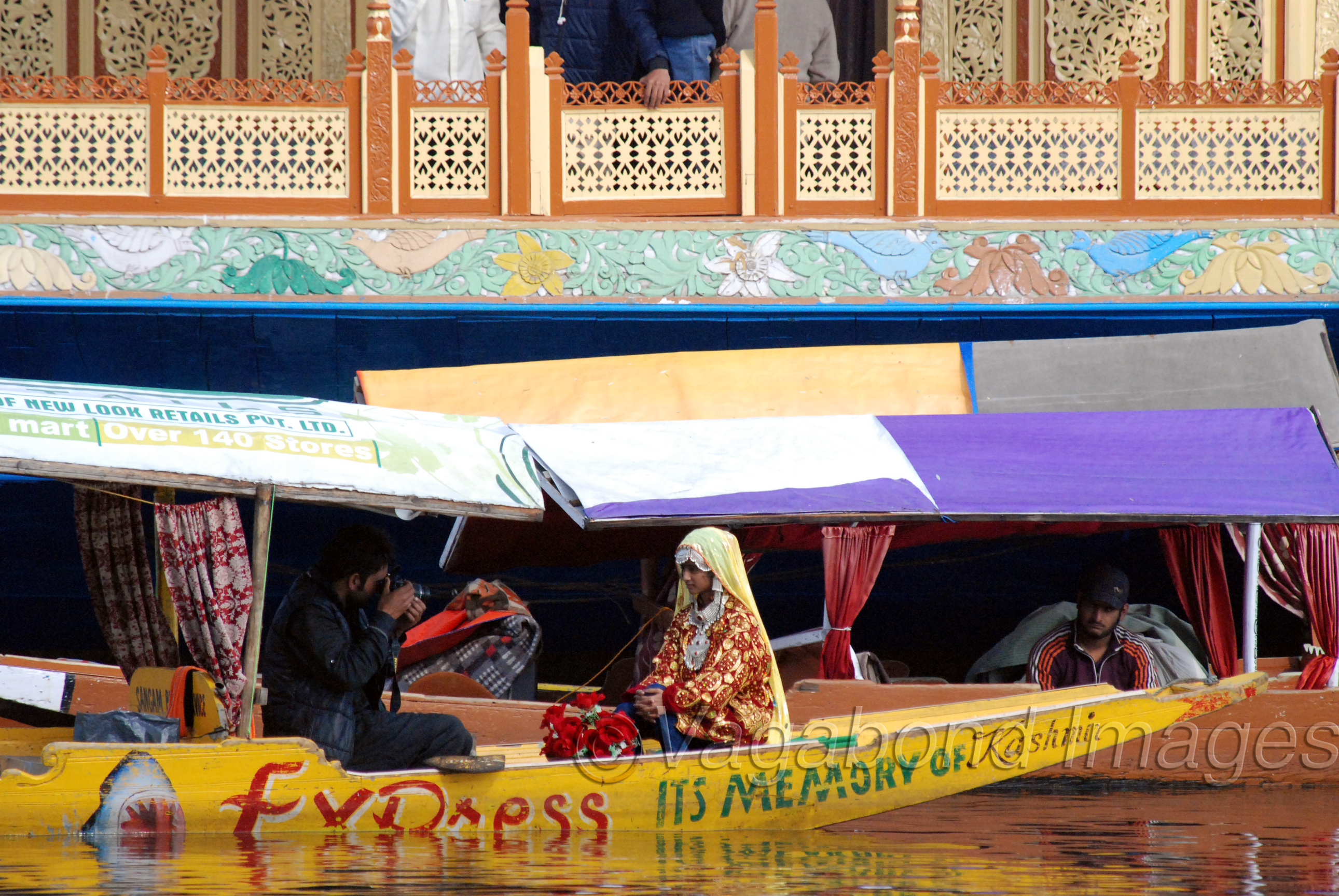 Getting clicked in a Kashmiri dress on a Shikara is one of those things tourists at Dal like the most