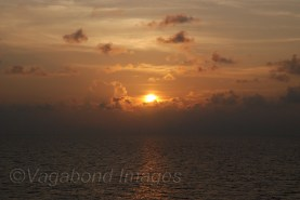 Sun sets in the Maldivian sea saying goodbye to a fantastic trip