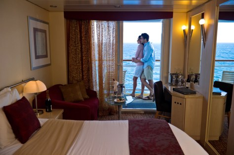 A couple enjoying in the balcony of a Stateroom