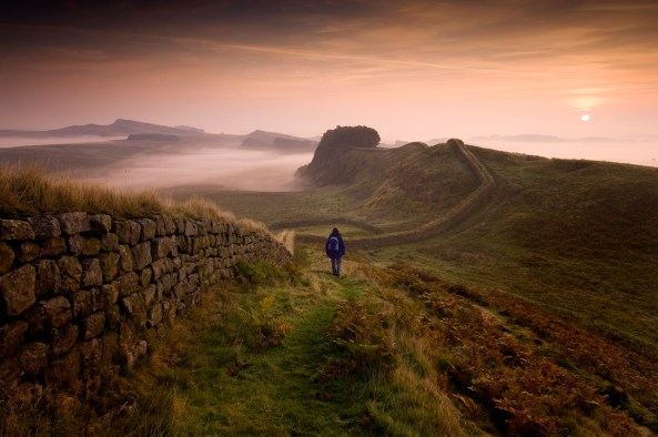View along Hadrian's Wall towards sunrise near Housesteads Fort in Northumberland