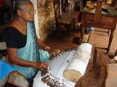 An aged woman creating a well known lace work of Sri Lanka is herself an attraction for tourists.