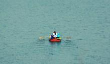 Tourists enjoying boating.