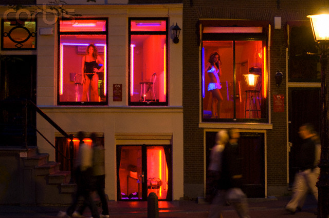 25 Jun 2007, Amsterdam, Netherlands --- Women Soliciting Customers in Amsterdam's Red Light District --- Image by © Atlantide Phototravel/Corbis
