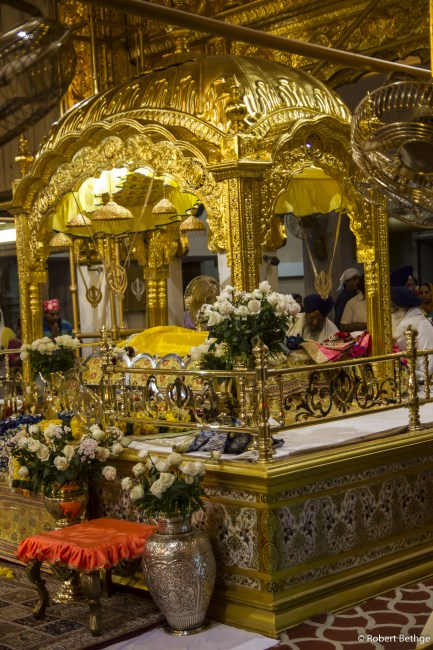 Sikh Ceremony around a golden shrine