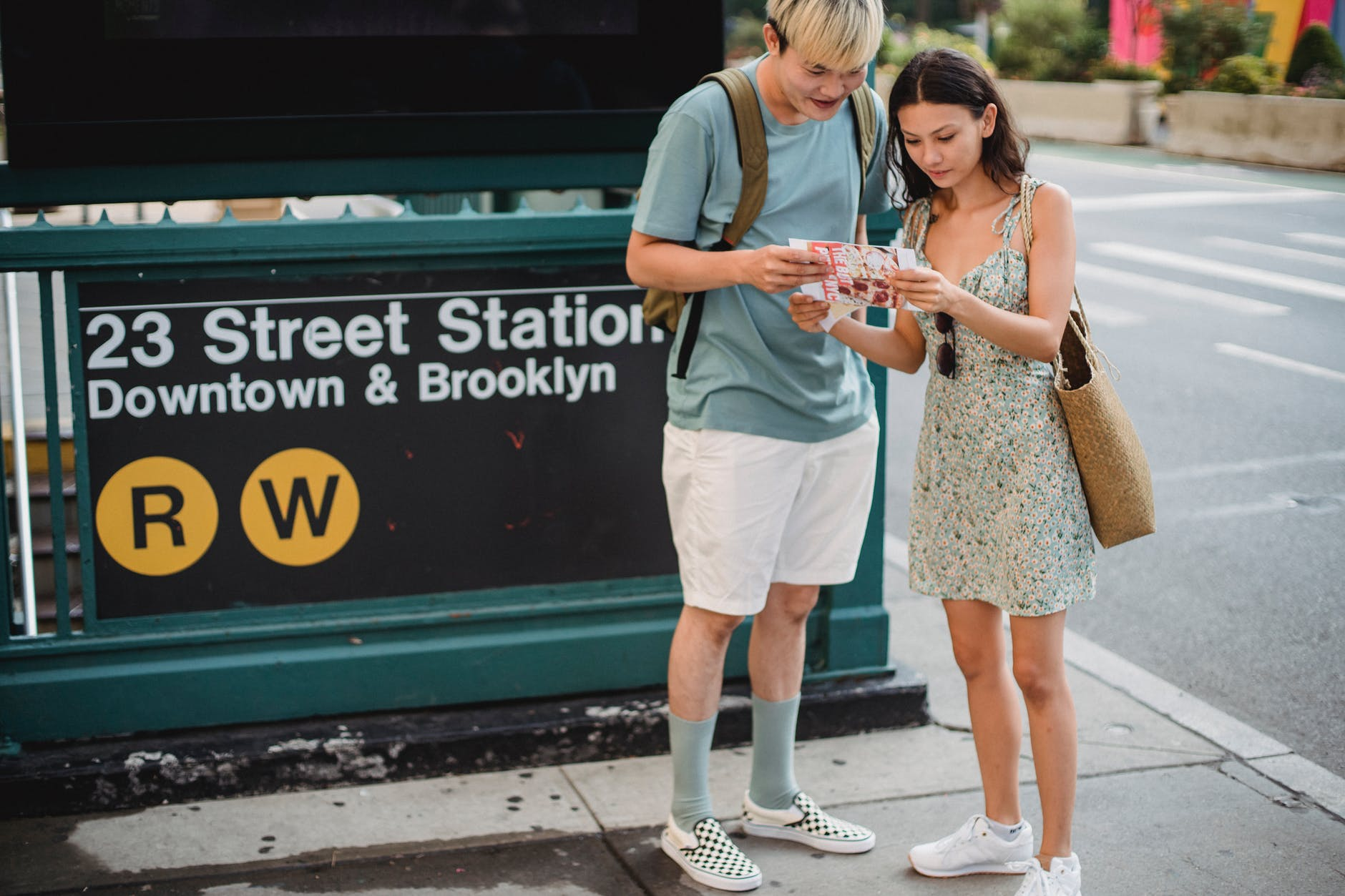 serious diverse couple searching way on map