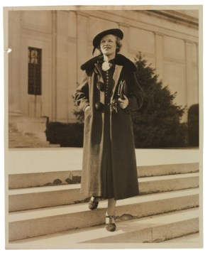 "Dorothy Elizabeth Hicks (1915-2002), circa 1937. Hicks modeled this fashionable outfit in front of ""Battle Abbey,"" the colloquial moniker for the building which then housed the Confederate Memorial Association. By 1946 the Confederate Memorial Association was subsumed by the Virginia Historical Society; the society moved its headquarters to Battle Abbey in 1959. A photograph of Hicks (then ""Miss Dorothy Walton"") similar to this one appeared in a local newspaper; both of these images are found in her scrapbook. (VHS call number: Mss5:7 H5292:1)"