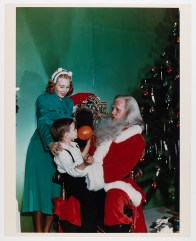 An early photograph of a young boy visiting Legendary Santa (Virginia Historical Society, 2002.440.8)