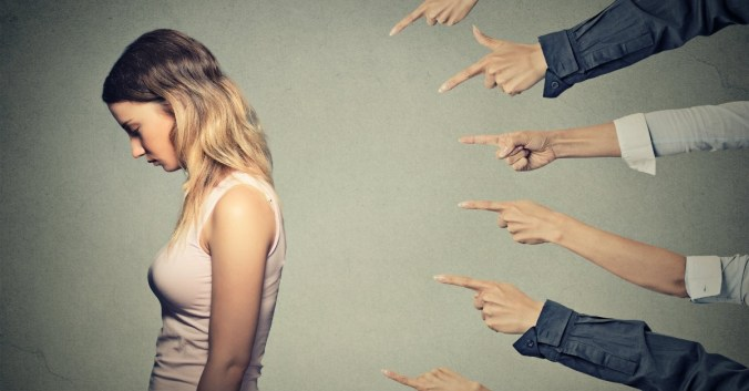 shame guilt woman pointing fingers sad