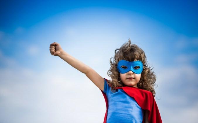 Child playing super heroe