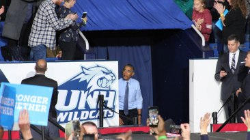 """Durham, NH: President Obama enters the arena at Whittemore Center Arena to address the crowd in order to """"Get Out The Vote."""" Photo by Vaishnavee Sharma/ BU News Service."""